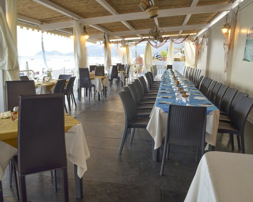 An indoor fine dining restaurant with a beach view.