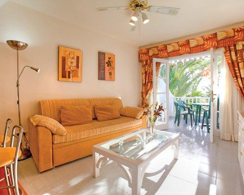 A well furnished living area alongside a patio.