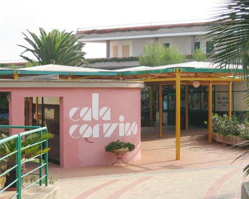 An exterior view of the Hotel Villaggio Cala Corvino resort.