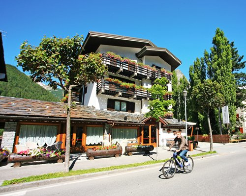 A man cycling on a road alongside the resort.