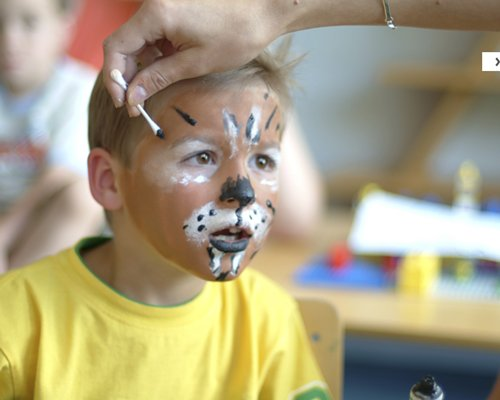 A kid with face painting.