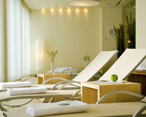 A well furnished spa room with chaise lounge chairs.