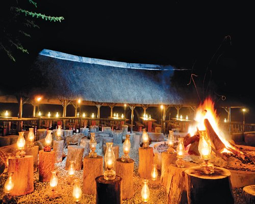 A camp fire area surrounded by candle themed lights.