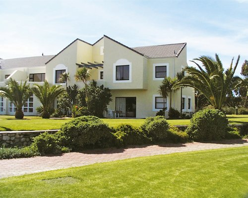 Exterior view of a unit at Langebaan Country Club with a pathway.