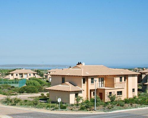 Street view of resort units alongside the beach.