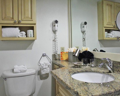 A bathroom with an open sink and vanity.