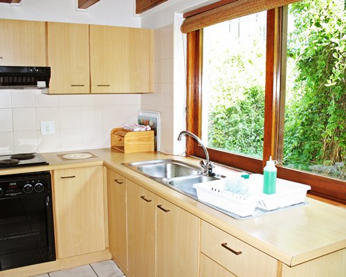 A well equipped kitchen with an outside view.
