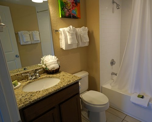 A bathroom with a shower bathtub and sink vanity.