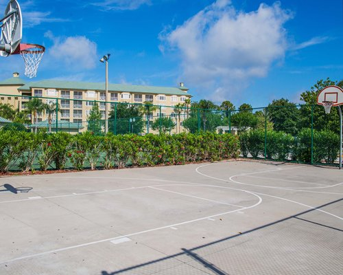 An outdoor basketball court alongside the resort.