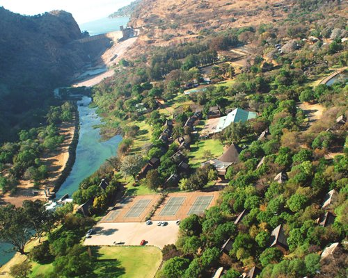 An aerial view of Mount Amanzi with outdoor recreation area and parking lot alongside a lake.