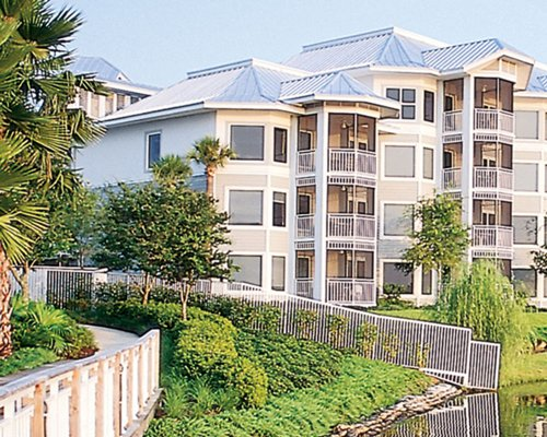 Scenic exterior view of multiple unit balconies at Cypress Harbour.