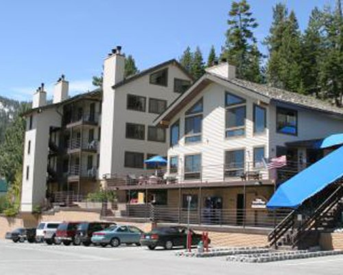 An exterior view of the multi story resort units with car parking.