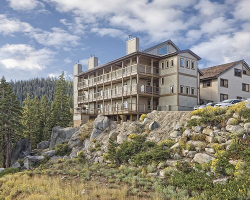 Exterior view of WorldMark Tahoe surrounded by wooded area.