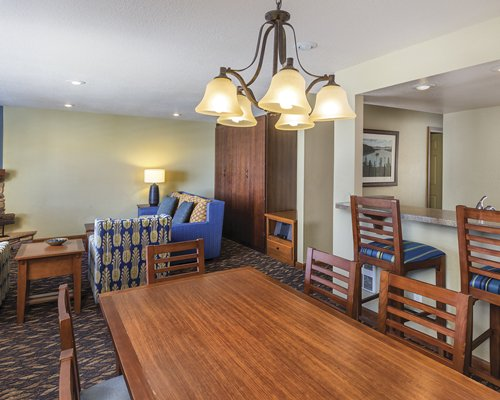 A well furnished living room with a dining area and breakfast bar.