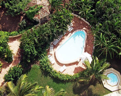 An aerial view of outdoor swimming pool and hot tub.
