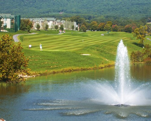 View of golf course with fountain.