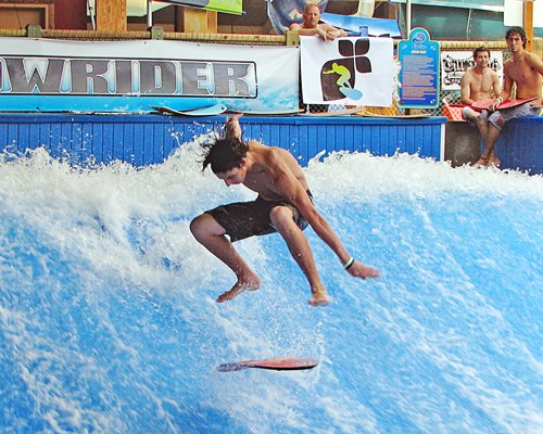 A person surfing in a water park.