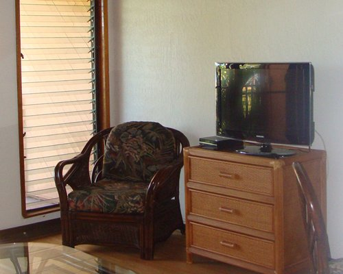 A television alongside a chair.
