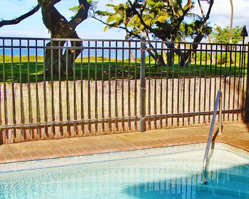 Outdoor hot tub at Kapulanikai Vacation Suites.