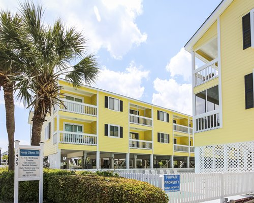 Scenic exterior view of the Sandy Shores III resort with private balconies.