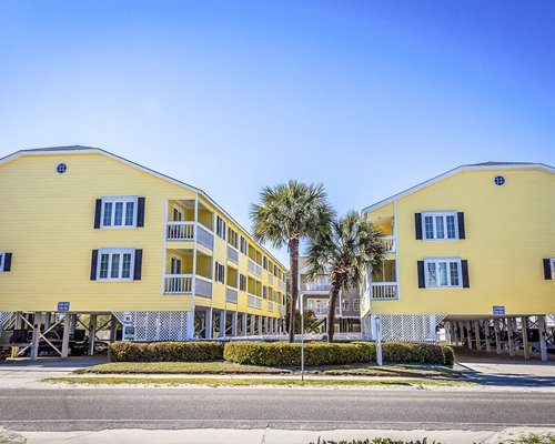 Scenic exterior view of Sandy Shores with multiple unit balconies.