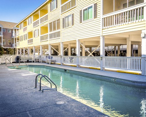 An outdoor swimming pool alongside the resort condos.