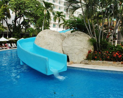 Units overlooking a pool with a water slide.