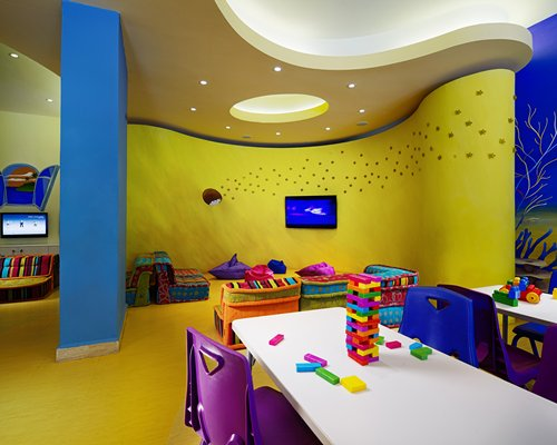 An indoor playscape area with television.