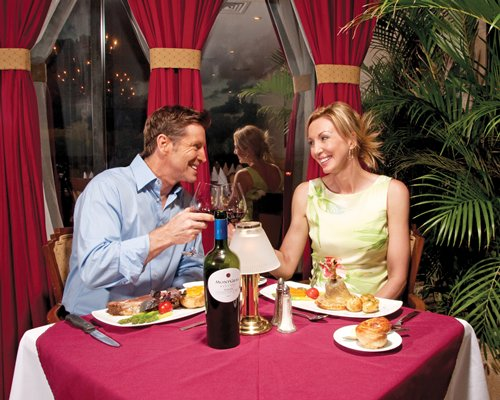 A couple dining in an indoor fine dining restaurant.