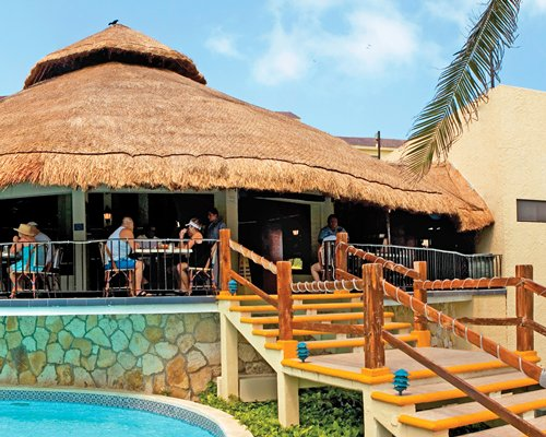 An outdoor snack bar alongside the swimming pool.