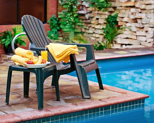 A view of patio furniture alongside the indoor swimming pool.