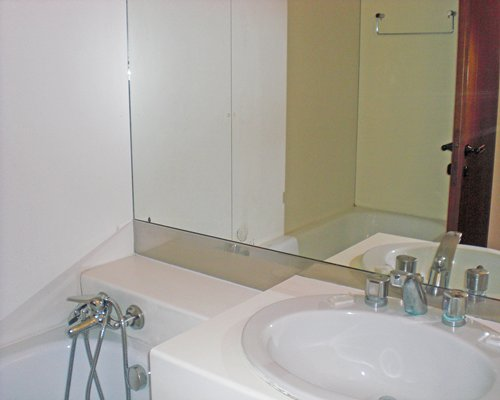 A bathroom with a sink and bath tub.