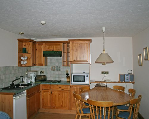 An open plan dining and kitchen area.