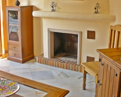 A view of the fireplace in the living room.