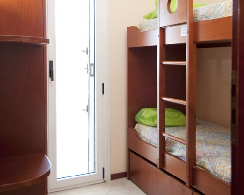 A well furnished bedroom with bunk bed.