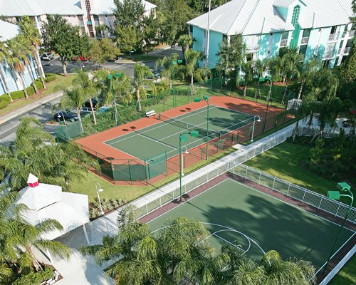 An aerial view of an outdoor play area with tennis court.
