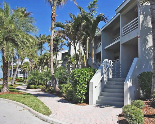 An exterior view of the resort with a pathway and landscaping.