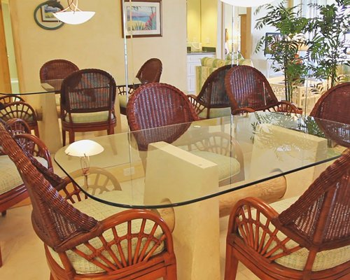 A well  furnished glass top dining table.