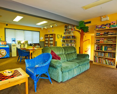 An indoor recreational room with bookshelves.