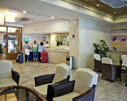 Reception and lounge area at Sandos Benidorm Suites.