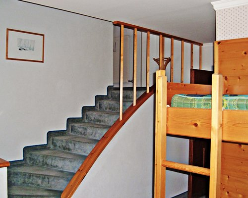 A stairway and bunker bed.