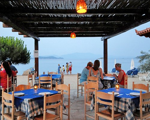 An outdoor restaurant alongside the beach.