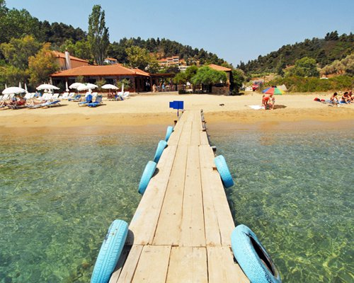 A wooden pier leading to the beach.