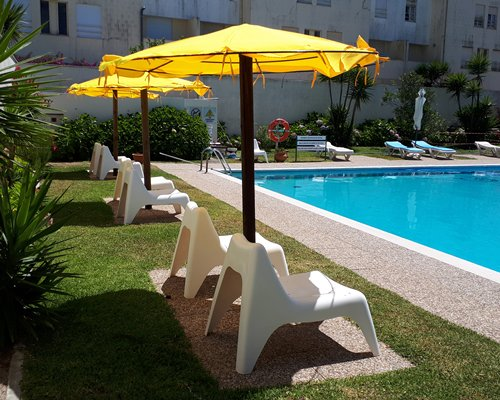 Outdoor swimming pool with chaise lounge chairs.