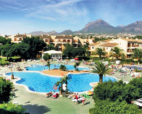 Scenic exterior view of an outdoor swimming pool at Albir Garden.