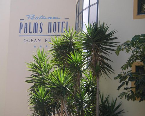 A view of the Pestana Palms resort name engraved in the wall.