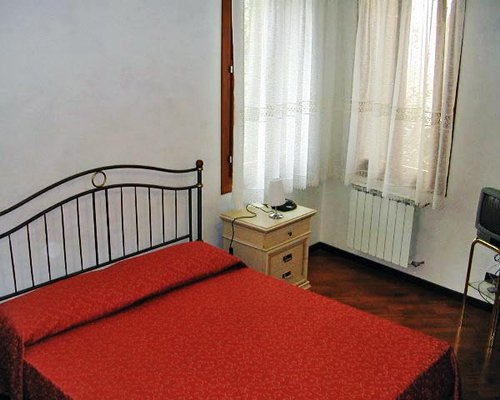 A well furnished bedroom with television.