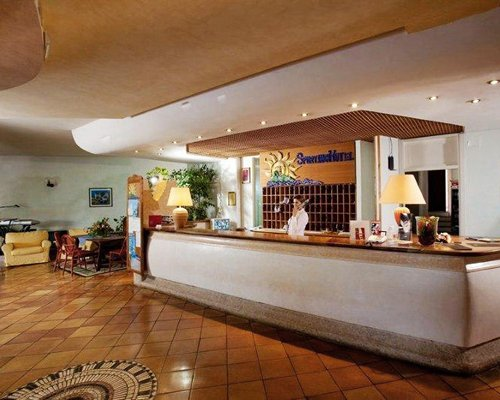 A well furnished reception of the Sporting Hotel Tanca Manna.