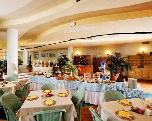 A well equipped indoor restaurant at Sporting Hotel Tanca Manna.