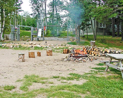 Scenic picnic area with camp fire and playscape.